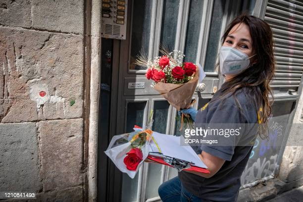 Delivery courier seen delivering a roses at home during Sant Jordi Day. Catalonia celebrates the popular Sant Jordi Day in doors during an emergency...
