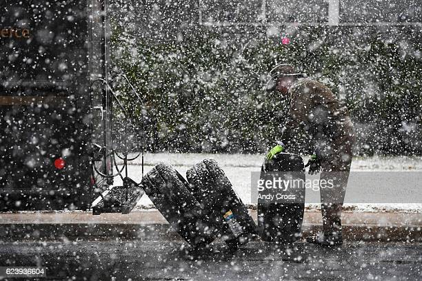 UPS delivery driver Even Griffiths unloads tires at the Discount Tire shop at Colorado Blvd and Dickenson Pl during heavy snow Thursday afternoon...