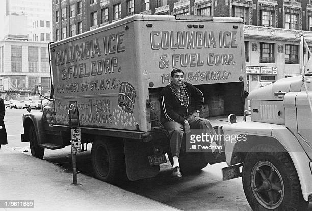 A delivery driver takes a break on the back of a 'Columbia Ice and Fuel Corp' truck' New York City 1966