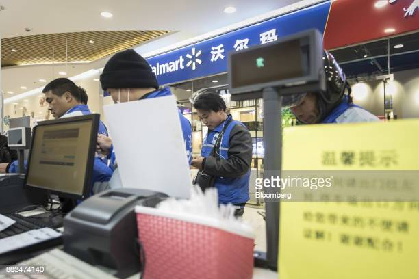Delivery drivers assigned by JDcom Inc's Dada app wait for orders outside a WalMart Stores Inc miniwarehouse for WalMart's onehour delivery service...