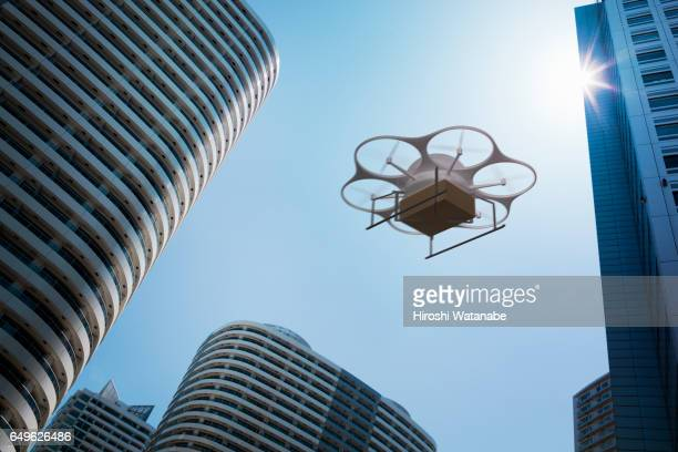 Delivery drone flying above high rise apartments