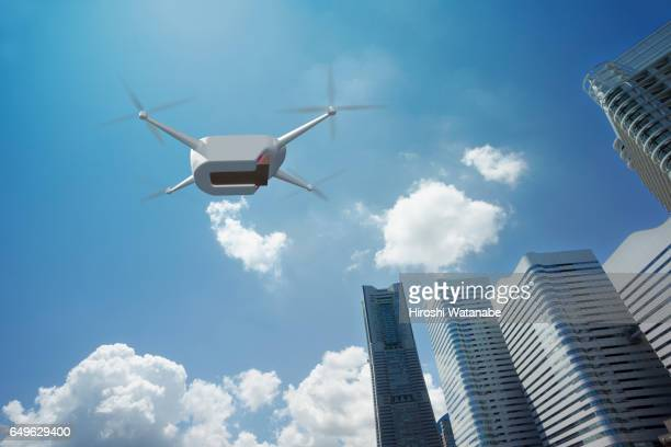 Delivery drone flying above high rise office buildings