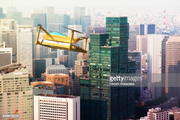 Delivery drone flying above the city