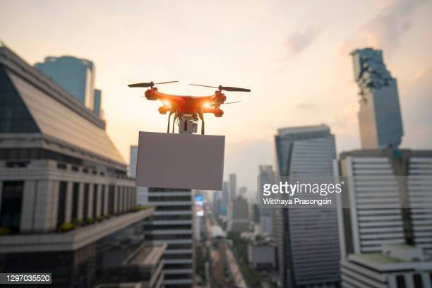 delivery drone flying in new york city - 2015 stock pictures, royalty-free photos & images