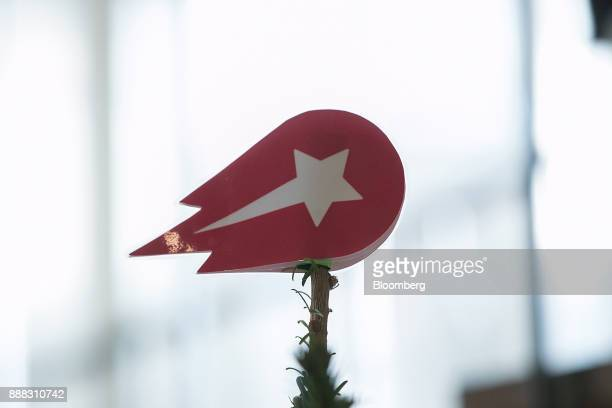 A Delivery Hero AG logo sits atop a Christmas tree in the reception area of the company's headquarter offices in Berlin Germany on Friday Dec 8 2017...
