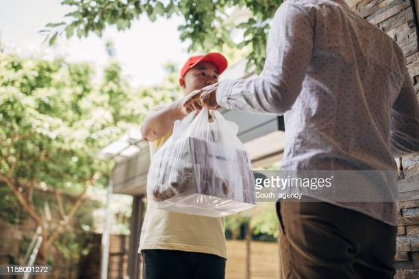 delivery man bringing food - box container stock pictures, royalty-free photos & images