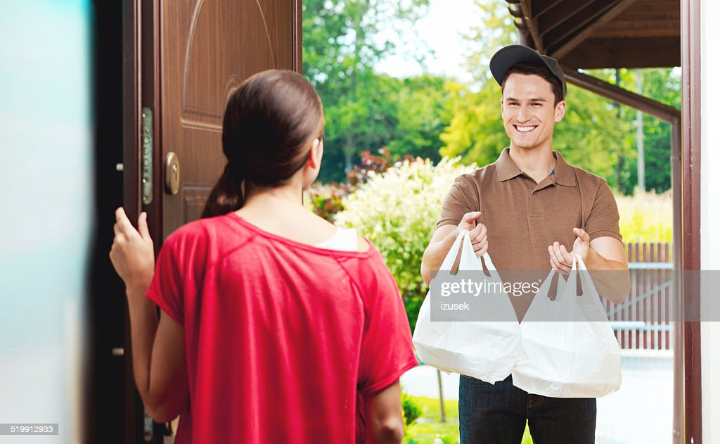 Delivery man delivering chinese take away food : Stock Photo
