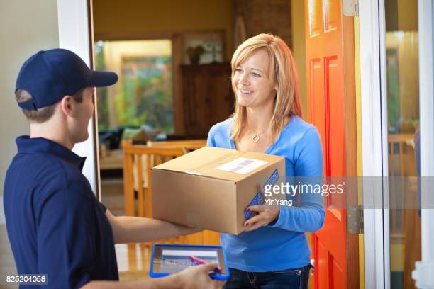 delivery man delivering package to woman customer at the door - open source stock pictures, royalty-free photos & images