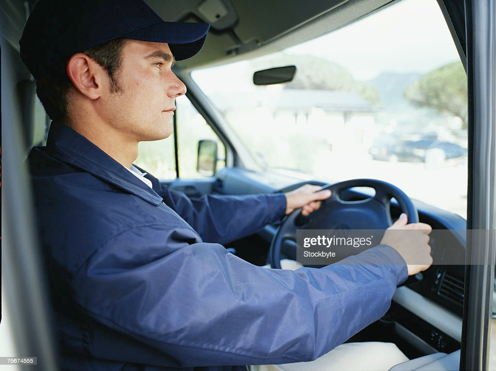 Delivery Man Driving Van Side View Closeup Stock Photo | Getty Images