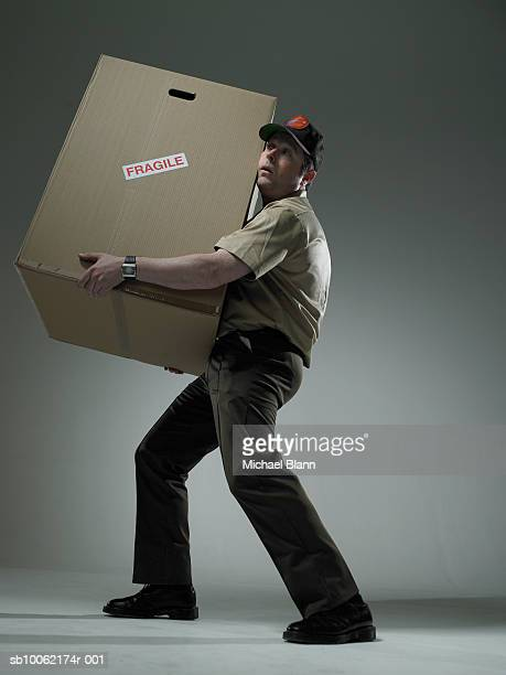 Delivery man holding large box