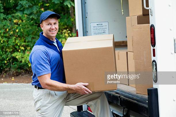 delivery man - carrying stock pictures, royalty-free photos & images