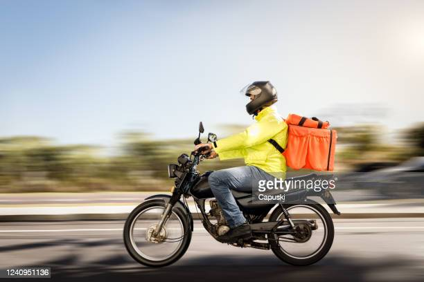 delivery man riding a motorcycle - motoboy - delivery person stock pictures, royalty-free photos & images