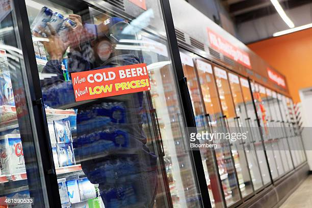 A delivery man stocks beer at a Family Dollar Stores Inc location in Mansfield Texas US on Tuesday Jan 7 2014 Family Dollar Stores Inc is expected to...