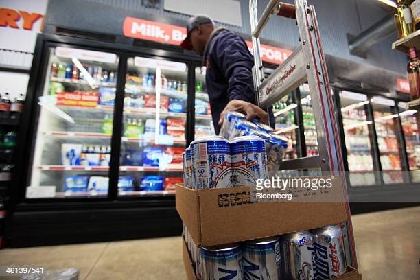 A delivery man stocks beer at the coolers inside a Family Dollar Stores Inc location in Mansfield Texas US on Tuesday Jan 7 2014 Family Dollar Stores...