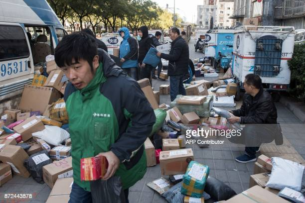 Delivery men sort boxes on the eve of Singles Day in Beijing on November 10 2017 Hundreds of millions of Chinese have their fingers at the ready for...