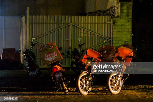 Delivery motorcycles stand alone as most commerce starts to go down after the presidency decided to restrict restaurants cafes and dining rooms to...
