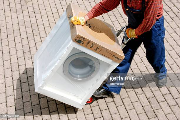 delivery - new washing machine - appliance stock pictures, royalty-free photos & images