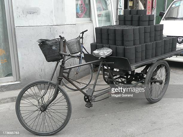 CONTENT] Delivery of coal blocks used for heating in a Beijing HuTong