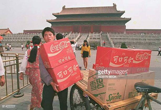 A delivery of CocaCola and Sprite soft drinks is unloaded at an inner hall of the Forbidden City one of the main Beijing tourist sites 25 May...