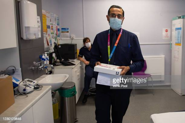 Delivery of the Pfizer/BioNtech covid-19 vaccine at Feldon Lane Surgery, as hundreds of Covid-19 vaccination centres run by local doctors begin...