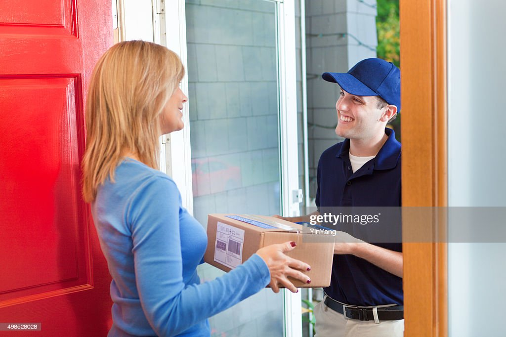 Delivery Person Delivering Package Box Container to Home Customer : Stock Photo