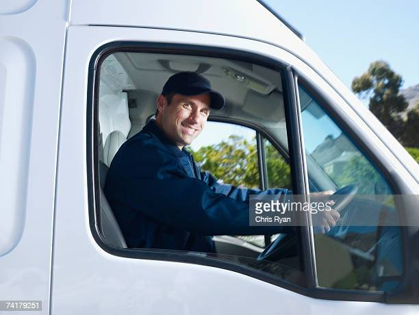 delivery person driving van - van stock pictures, royalty-free photos & images