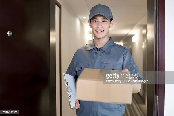 Delivery person holding package