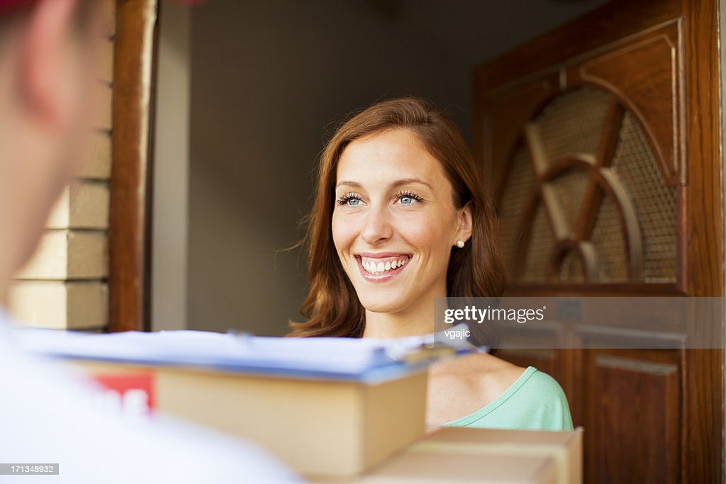 Delivery person with packages. : Stock Photo