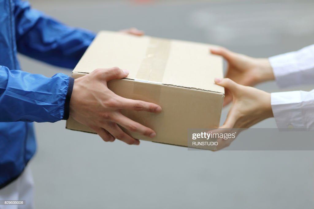 Delivery person with packages,close up : Stock-Foto