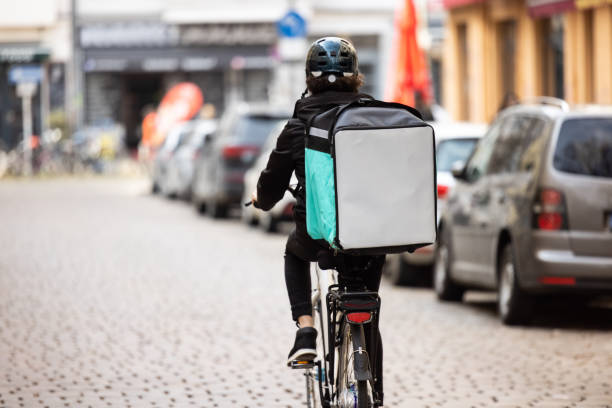 delivery person with thermal box on a bicycle in town picture