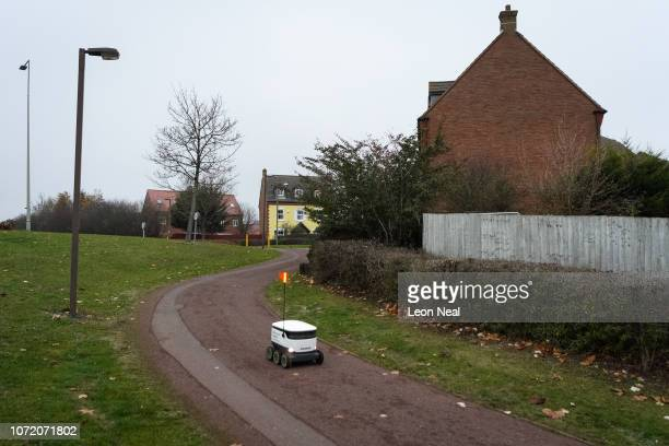 Delivery robot travels along a pavement as it makes a home delivery of groceries from the Co-op food store on November 23, 2018 in Milton Keynes,...