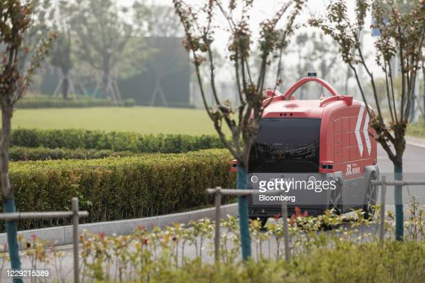 Delivery robot travels through the city during a media tour of JD.com Inc.'s autonomous delivery vehicles in Changshu, Jiangsu province, China, on...