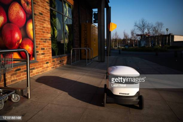 Delivery robot waits for the next order to arrive before it makes a home delivery on March 27, 2020 in Milton Keynes, England. With the country...