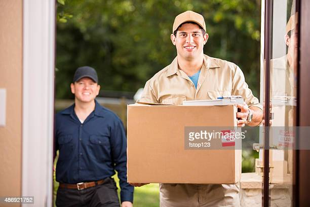 Delivery service. Latin man delivers package to customer. Home. Door.
