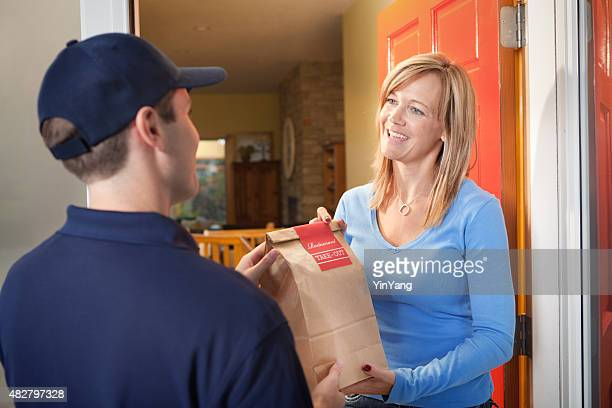 Delivery Service Man Delivering Take-out Food Bag to Customer Door