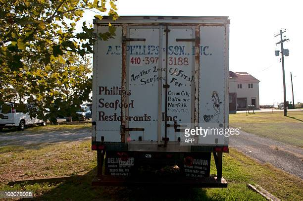 A delivery truck is parked in the shade of a street across the street from the AE Phillips Inc plant in Fishing Creek MD July 22 2010 The plant is...