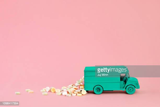 Delivery truck with pastel candies spilling out the back.