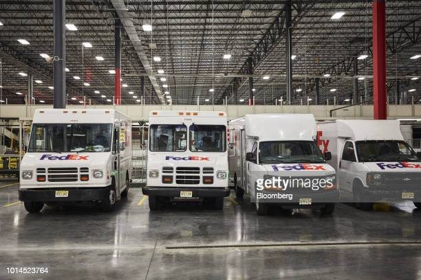 Delivery trucks sit parked at the FedEx Corp Ground distribution center in Jersey City New Jersey US on Tuesday Aug 7 2018 FedEx is heading into...
