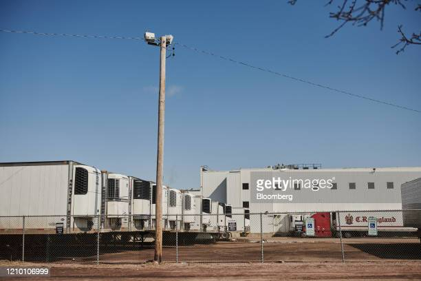 Delivery trucks sit parked outside the closed Smithfield Foods Inc plant in Sioux Falls South Dakota US on Wednesday April 15 2020 South Dakota...
