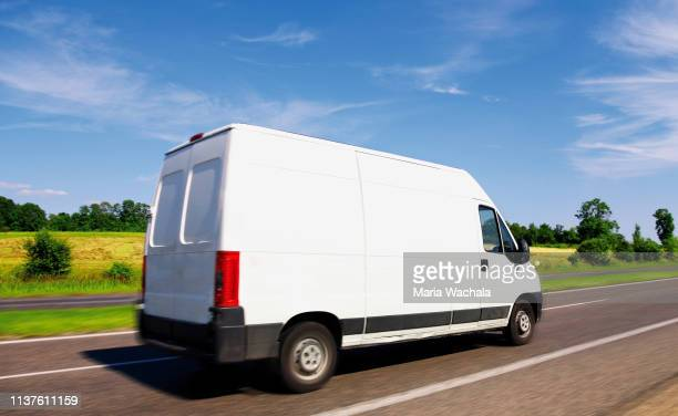 delivery van  driving on highway - commercial land vehicle stock pictures, royalty-free photos & images