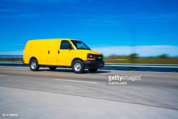 delivery van on the highway - car transporter stock photos and pictures