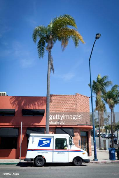 A USPS delivery van parked in Little Italy