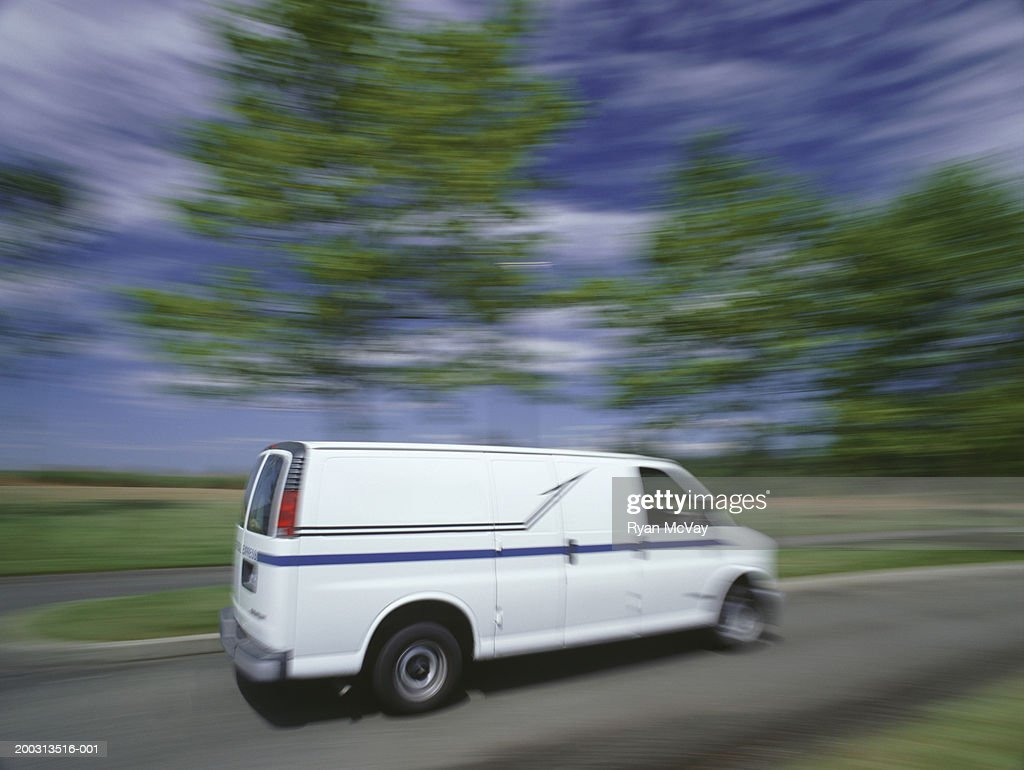 Delivery van travelling on country road : Foto de stock
