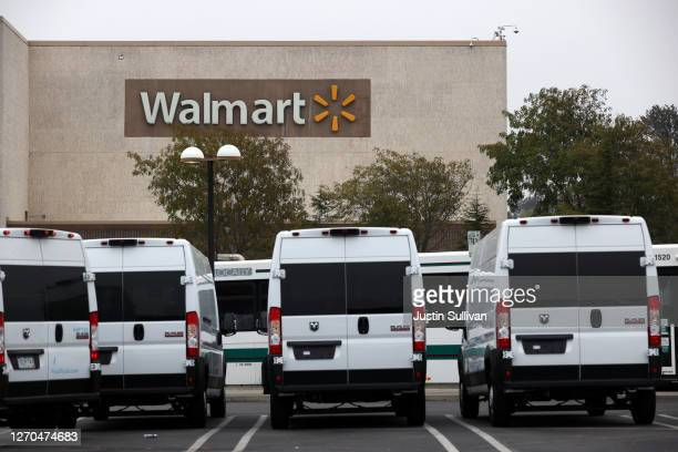 Delivery vans are parked in front of a Walmart store on September 03, 2020 in Richmond, California. Walmart has announced plans to launch Walmart...