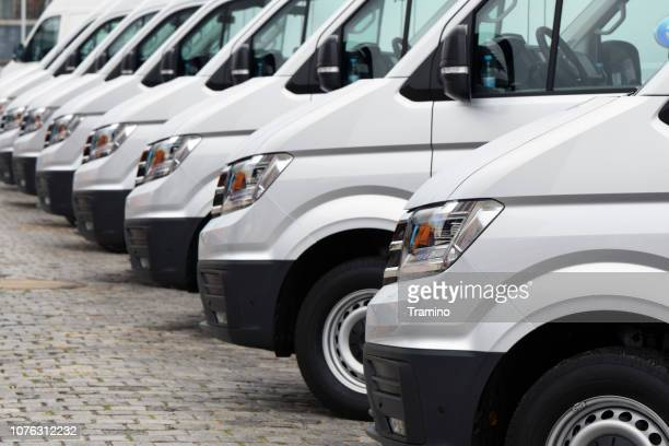 delivery vans parked on the parking - alternative fuel vehicle stock pictures, royalty-free photos & images