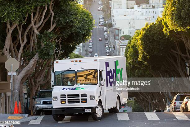 delivery vehicle of fedex in san francisco, usa - fedex truck stock pictures, royalty-free photos & images