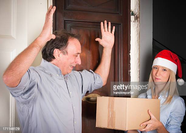 delivery  woman with handing over present packets - christmas time