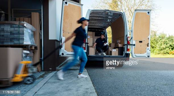 delivery workers loading delivery van - loading dock stock pictures, royalty-free photos & images
