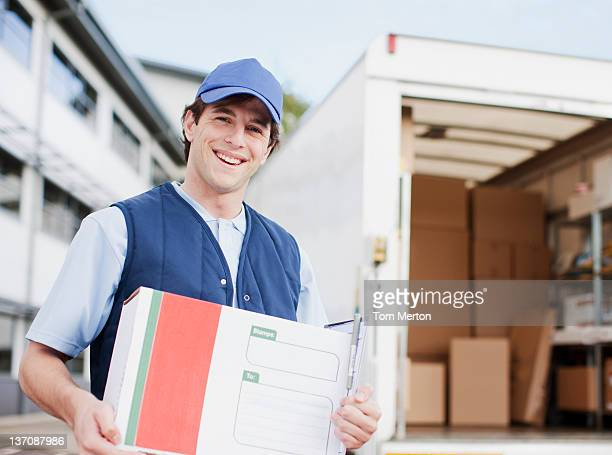 Deliveryman holding package