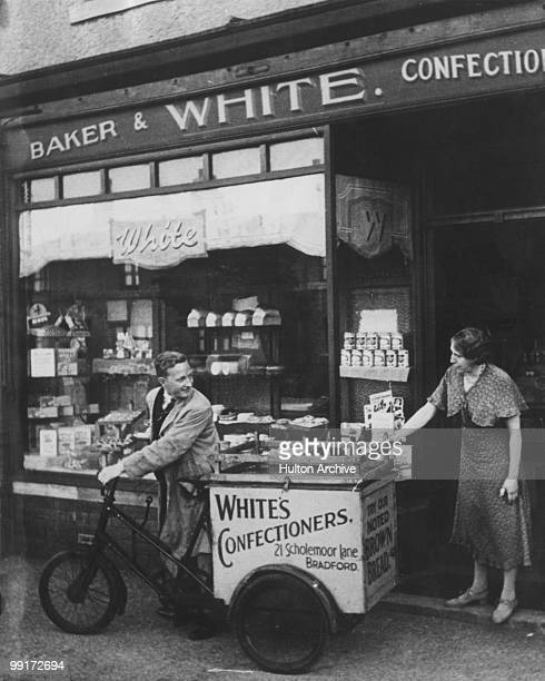 A deliveryman leaves White's confectioners shop at 21 Scholemoor Lane Bradford 1938